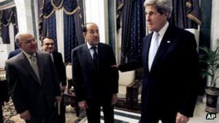 John Kerry (right) and Iraqi Prime Minister Nouri al-Maliki (second right), 24 March 2013