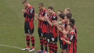 AFC Bournemouth players applaud