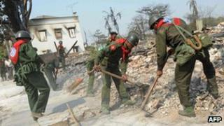 Soldiers take part in clean-up operations after an outbreak of deadly communal violence claimed in Meiktila, central Burma, on 24 March 2013