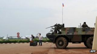 A French armored personnel carrier patrols on March 25, 2013 at Bangui airport.