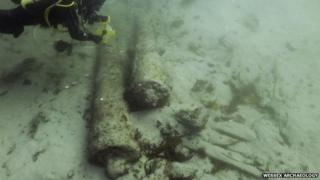 Diver and two cannons