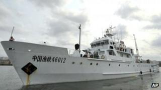 In this photo released by China's Xinhua News Agency, a Chinese fishery administration ship leaves the Xingang Port of Haikou, capital of south China's Hainan Province, Tuesday, March 26, 2013, to conduct patrol missions in waters off the Paracel Islands and Scarborough Shoal in the South China Sea.