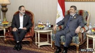Ahmed Moaz al-Khatib (left) with Egypt's President Mohammed Morsi in Qatar, 27 March