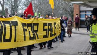 Protesters face police during Wednesday's peaceful protest at Sussex House