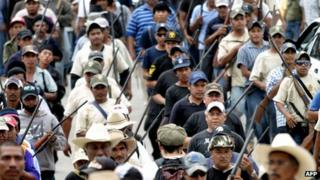 Armed vigilantes marching in Ayutla de los Libres, Guerrero State, 2 March 2013