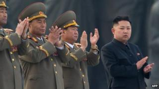 In a file picture taken on April 13, 2012, North Korean leader Kim Jong-Un (R) claps during the unveiling ceremony of two statues of former leaders Kim Il-Sung and Kim Jong-Il in Pyongyang.
