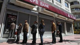 People queue for cash in Cyprus