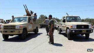 Libyan security officials guard a checkpoint in July 2012, file image