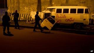 Police in Rio slum, March 3, 2013