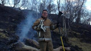 Fire Fighter Neil MacKellaig with Smokey the lamb