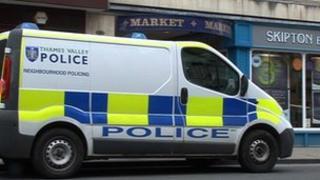 Police van outside covered market