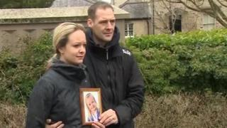 Kelsey Smart's mother, Hannah, holds a photo of her daughter