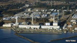 """An aerial view shows Tokyo Electric Power Co.""""s (TEPCO) tsunami-crippled Fukushima Daiichi nuclear power plant in Fukushima Prefecture March 11, 2013."""