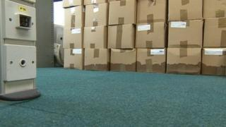 Damaged carpet and boxes in County Hall