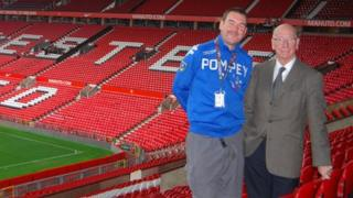Scott McLachlan with Sir Bobby Charlton at Old Trafford home of Manchester United