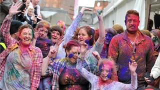 Festival goers took the opportunity to cover each other in brightly coloured powder
