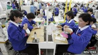 Workers make shoes at the Kaesong industrial park (file image)