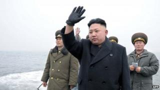 North Korean leader Kim Jong-un (C) waves to soldiers (5 April)