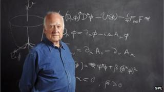 Prof Peter Higgs pictured with the Higgs mechanism equation on a blackboard