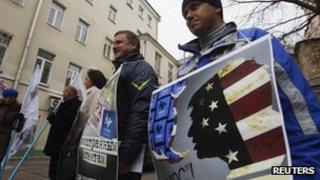 Protesters hold placards suggesting election monitoring non-governmental body Golos is an agent of the US during a protest against the organisation outside its offices in Moscow last Friday