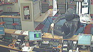 Ladbrokes robber armed with knife