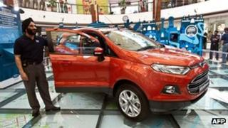 President and Managing Director of Ford India, Joginder Singh, poses with a Ford Ecosport