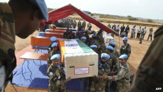 Coffins of Indian peacekeepers at a memorial service in Juba on April 10, 2013