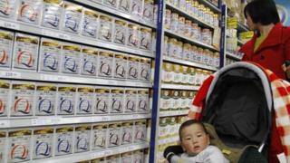 A mother and baby in a supermarket in Nanjing
