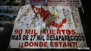 A banner decrying the high number of dead and missing during a march in Mexico City against violence in March 2013.