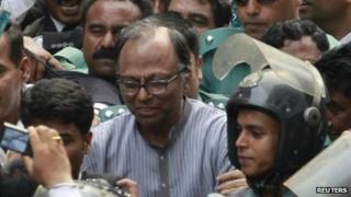 Police escort Mahmudur Rahman to court in Dhaka