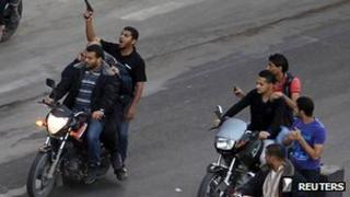 Armed men drag body of suspected collaborator through Gaza's streets. 20 November 2012