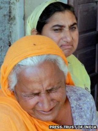 Family members of Devinder Pal Singh Bhullar in Bathinda, Punjab, on 12 April 2013