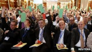 Delegates vote during the first party congress in Berlin on 14 April.