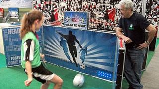 Kevin Keegan watches youngster playing Sokka game
