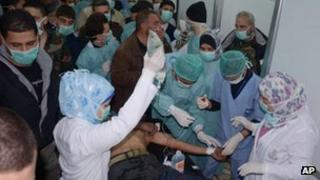 Photo released by the Syrian official news agency SANA, shows a Syrian victim who suffered an alleged chemical attack at Khan al-Assal village (19 March 2013)
