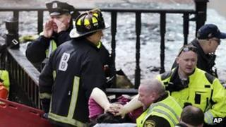 First responders care for an injured person at the Boston Marathon