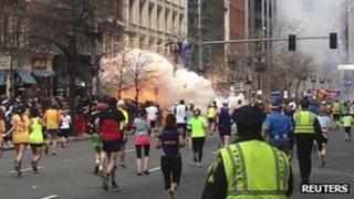 An explosion erupts near the finish line of the Boston Marathon