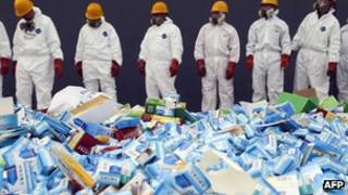 File photo: Health workers prepare to destroy fake medicines seized in Beijing in recent months, 14 March 2013