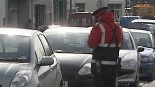 Parking attendant checking cars