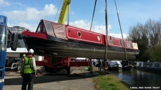 Narrowboat being lifted out of river in Aylesbury, Bucks
