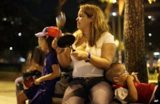An opposition supporter bangs a pan to protest against the official presidential election results in Caracas, Venezuela, 16 April