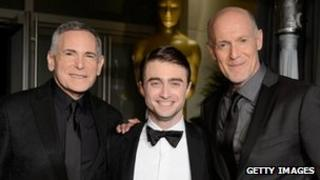 Craig Zadan and Neil Meron with Daniel Radcliffe (centre)