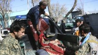 Afghan forces with the body of a comrade who was killed in Ghazni