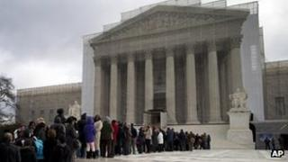 People wait to enter the US Supreme Court, February 2013