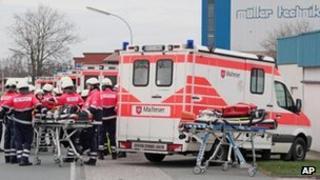 Ambulances outside plastics processing plant in Steinfeld (16 April)