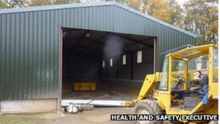 The barn with the roller shutter on the ground