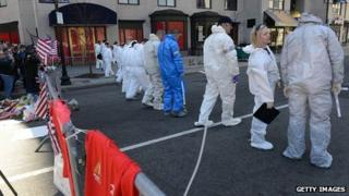 FBI crime scene investigators sweep up Boylston Street. 17 April 2013