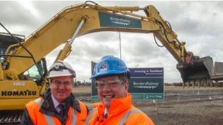 David Simpson, of Network Rail Scotland (L) and Transport Minister Keith Brown (R)