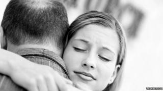 Generic image of father hugging daughter