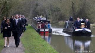 Funeral procession on Grand Union Canal